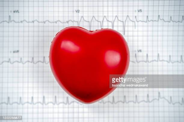 cardiogram with red heart on table, closeup - beating heart stock pictures, royalty-free photos & images