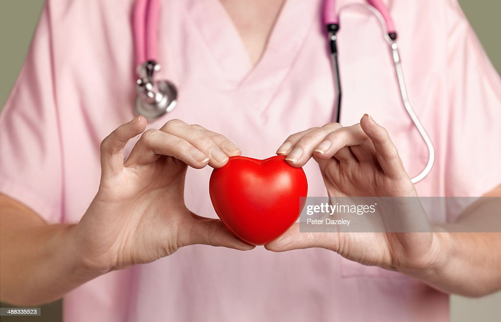 Cardiologist with heart : Stock Photo