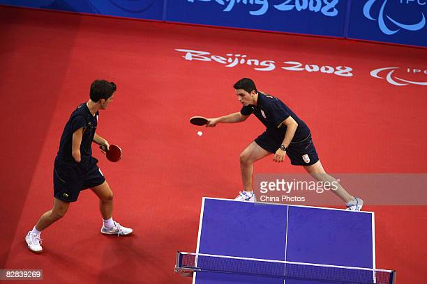 Cardona Jorge and Ruiz Jose Manuel of Spain compete against Ma Lin and Ge Yang of China in the Men's Team Class 9/10 Gold Mdl Table Tennis match...
