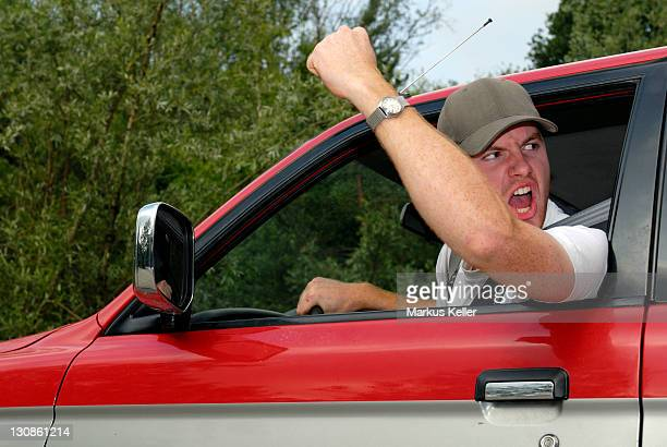 cardriver makes angry gestures - Germany, Europe