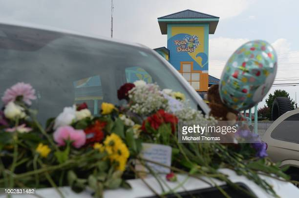 Cards and flowers are seen on the vehicle of one of the victims of the Ride The Ducks Accident at Ride The Ducks Tours on July 20 2018 in Branson...