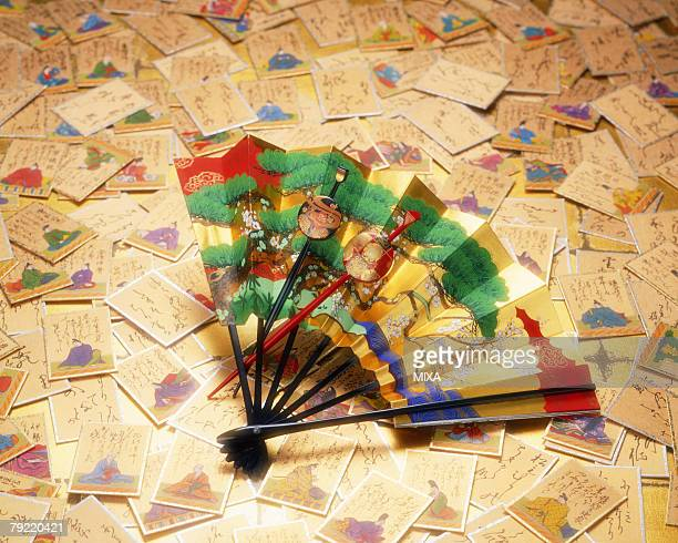 Cards and folding fan