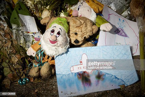 Cards and stuffed animals are left in memory of the victims of Malaysia Airlines flight MH17 at the Korporaal van Oudheusdenkazerne in Hilversum...
