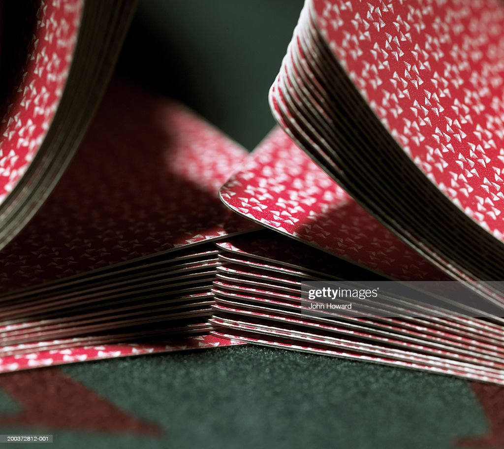 Cards being shuffled on gaming table, close-up : Stock Photo