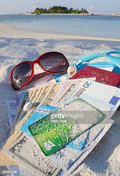 cards cash and belongings on beach