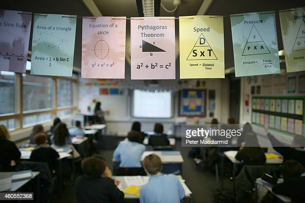 Cards displaying maths theories are displayed in a class room at a secondary school on December 1 2014 in London England Education funding is...