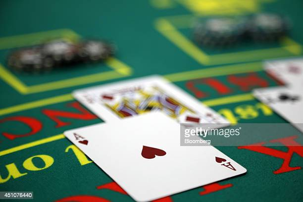 Cards sit on a blackjack table at the Japan Casino School in Tokyo Japan on Monday June 16 2014 At Japan Casino School anticipation for the passage...