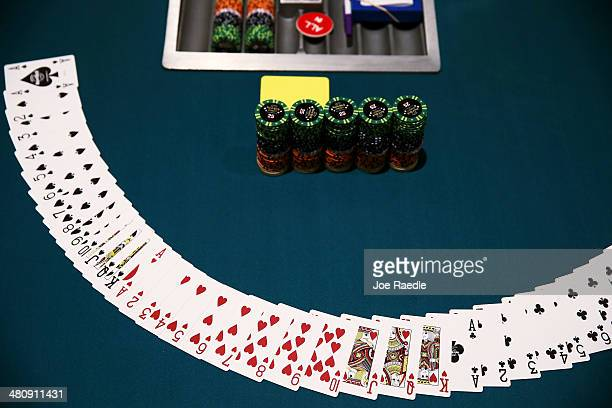 Cards sit on a poker table as its prepared during the opening day of the Seminole Hard Rock Poker Showdown on March 27 2014 in Hollywood Florida The...