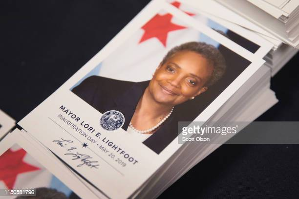 Cards with a picture of Mayor Lori Lightfoot are passed out to visitors at City Hall following Lightfoot's inauguration ceremony on May 20 2019 in...