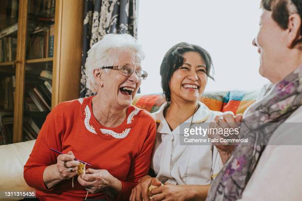 care assistant visits elderly woman - support stock pictures, royalty-free photos & images