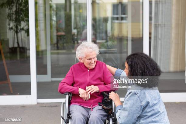 care for senior woman in wheelchair - 90 plus years stock pictures, royalty-free photos & images