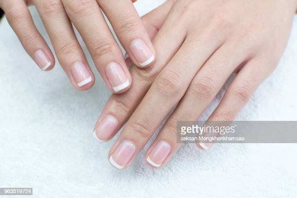 care for sensuality woman nails - manicure stock pictures, royalty-free photos & images