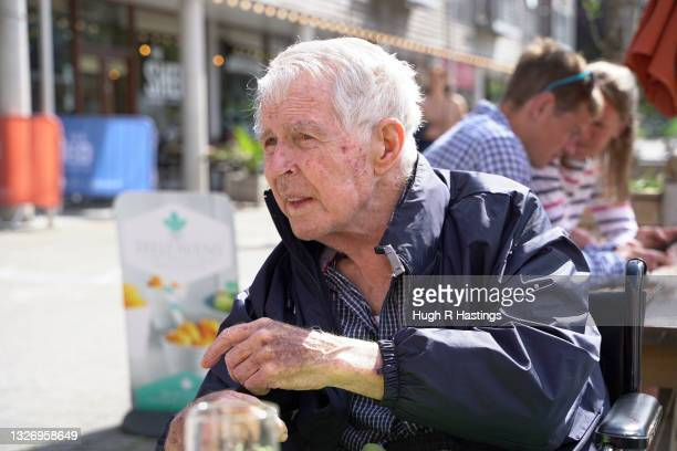 Care Home resident and Parkinson's dementia sufferer Gordon Wilkinson, aged 81, enjoys a visit to a local outside bar for a pint of beer for the...