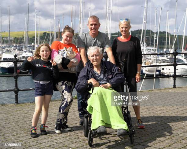 Care Home resident and Parkinson's dementia sufferer Gordon Wilkinson, aged 81, poses for the photographer with members of his family after enjoying...