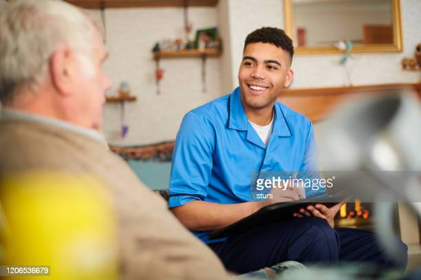 care nurse checking patient at home - community care stock pictures, royalty-free photos & images