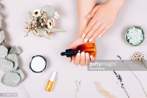 care procedure for hands - essential oil stock pictures, royalty-free photos & images