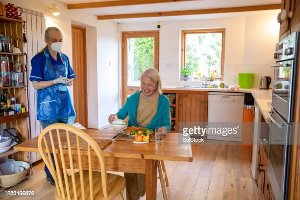 care with extra safety - apron stock pictures, royalty-free photos & images