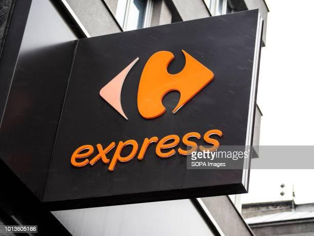Carefour express supermarket logo