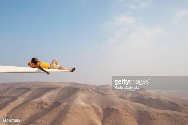 Carefree backpacker enjoying the nature of desert mountains.