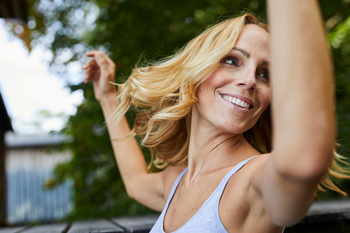 Carefree blond woman outdoors - gettyimageskorea