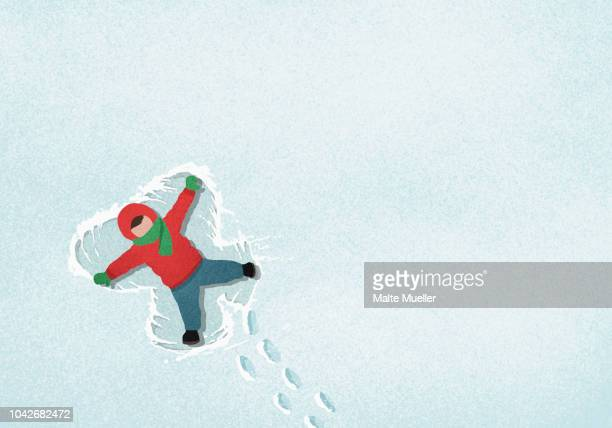 carefree boy making snow angel - illustration stock pictures, royalty-free photos & images