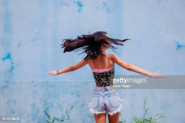 carefree brunette girl in motion