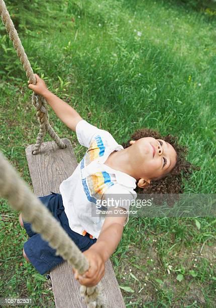 carefree child swinging - コロラド州 ニューキャッスル ストックフォトと画像