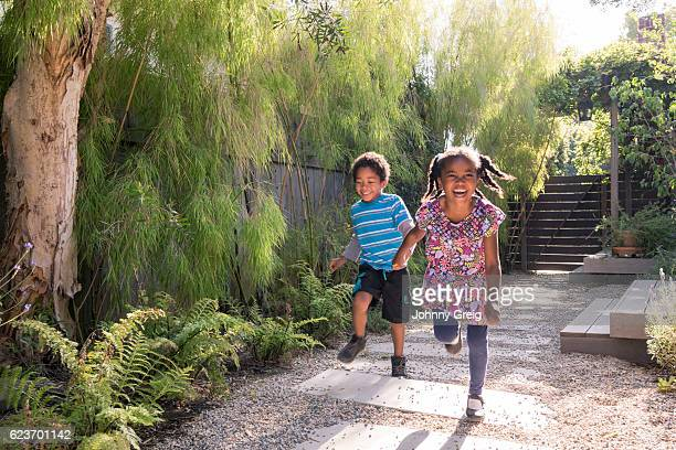 Carefree children running and playing in garden