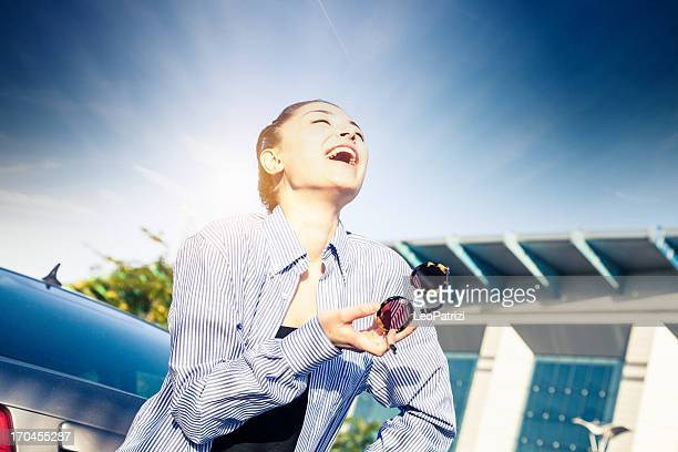 Carefree cute young woman smiling in parking