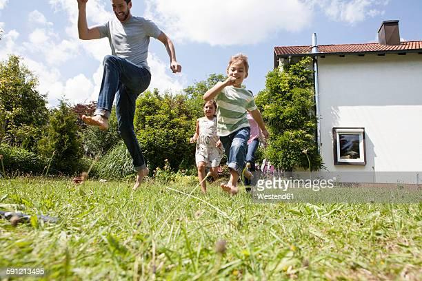 Carefree family running in garden