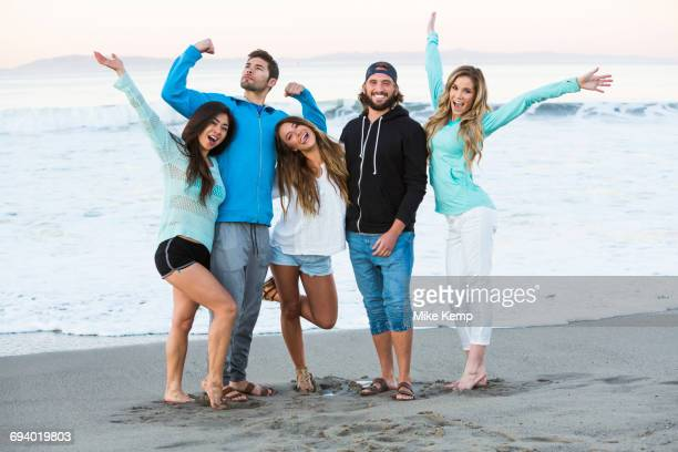 Carefree friends posing at beach
