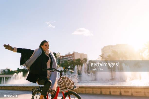 carefree girl riding bicycle in valencia,spain - valencia spain stock pictures, royalty-free photos & images
