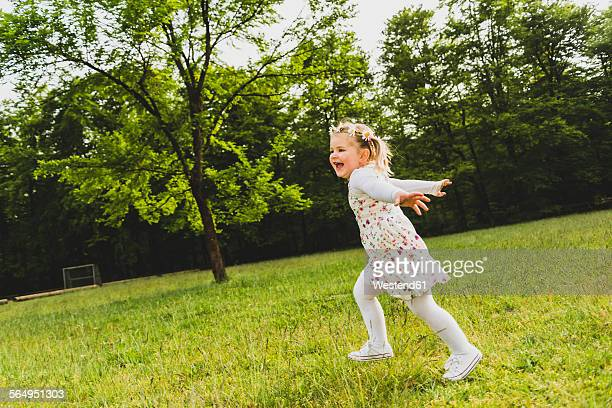 Carefree girl running on meadow
