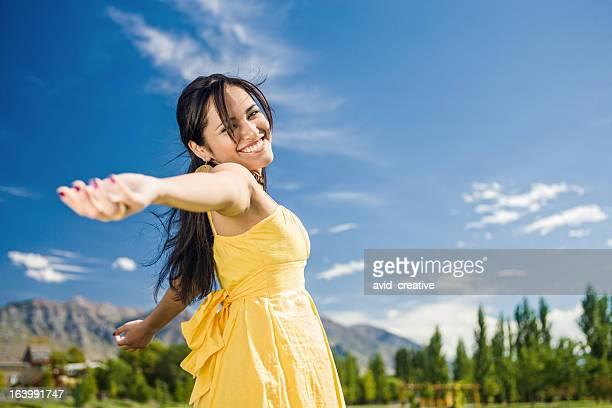 Carefree Girl Twirling Around