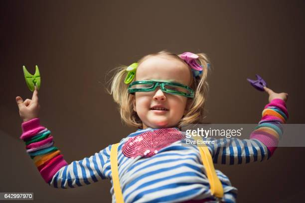 carefree, happy child wearing multi colors and dancing - futurism stock photos and pictures