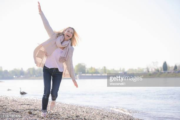 carefree mature woman at the riverside - carefree stock pictures, royalty-free photos & images