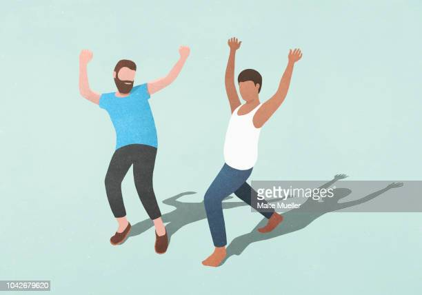 Carefree men dancing on blue background