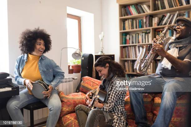 carefree musicians playing instruments and singing - tambourine stock photos and pictures