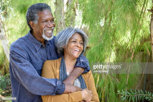 carefree senior african american couple laughing in garden - 60 69 years stock pictures, royalty-free photos & images