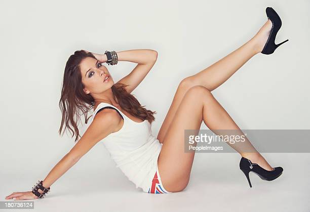 carefree sensuality - beautiful legs in high heels stock photos and pictures