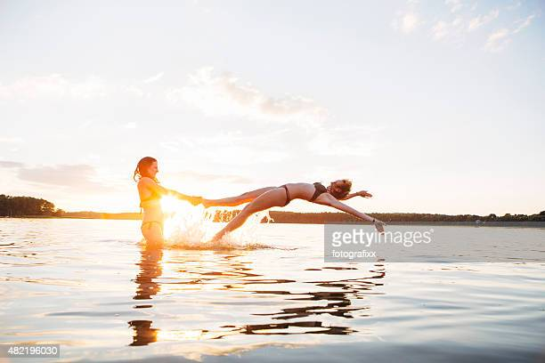 carefree summer day: young woman have fun in lake