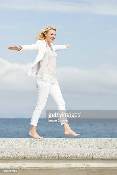 carefree woman by the sea - white pants stock pictures, royalty-free photos & images