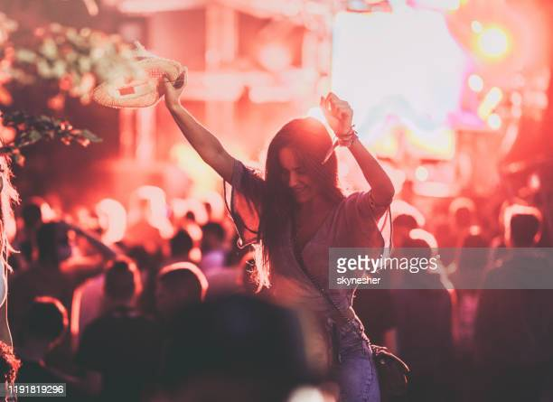carefree woman having fun on a music festival. - concert stock pictures, royalty-free photos & images
