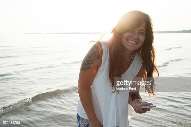 Carefree woman with cell phone