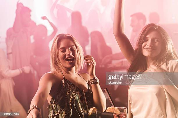 carefree women clubbing and having fun during night out. - ladies' night stock pictures, royalty-free photos & images