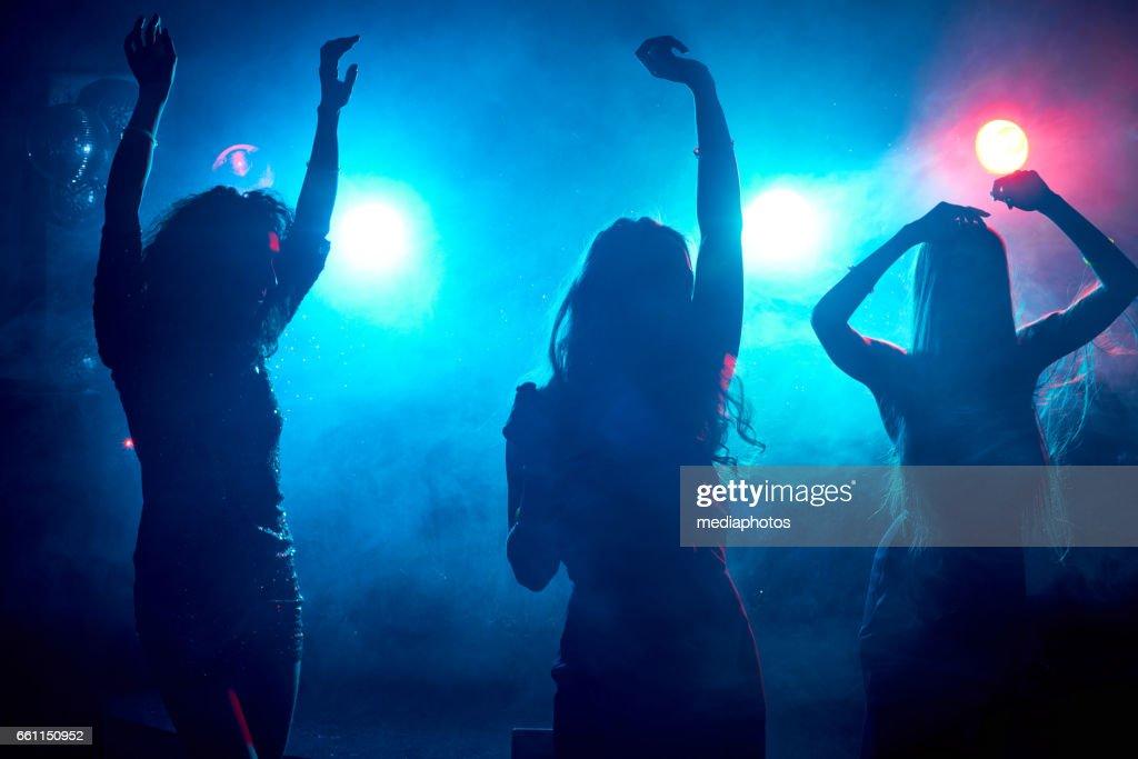 Carefree women dancing : Stock Photo
