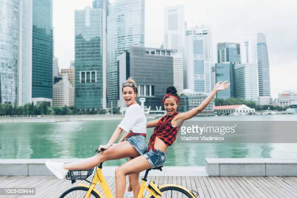 Carefree women enjoying biking