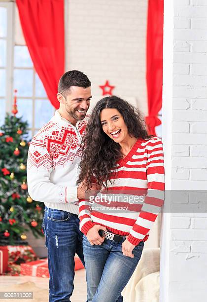 Carefree young couple resting at home for christmas