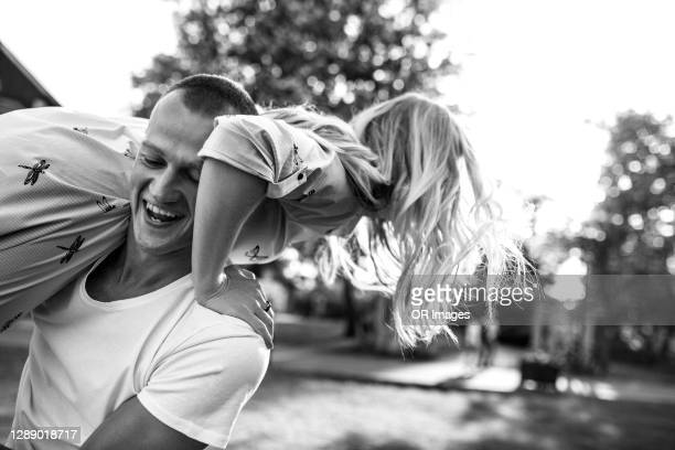 carefree young man carrying girlfriend - marriage stock pictures, royalty-free photos & images