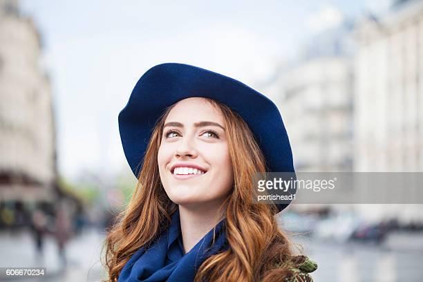 Carefree young woman having fun on street